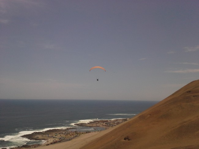 Paragliding above the beach