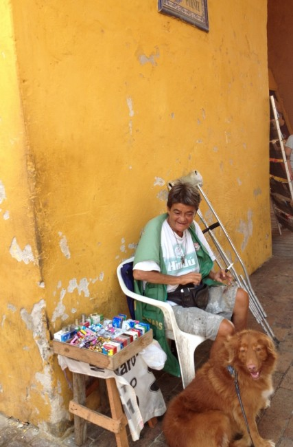 Capi made friends with a woman who sells gum and candies in old town.